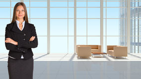 Businesswoman and large window in office building Stock Photos