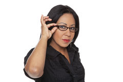 Businesswoman - Latina adjusting her glasses Stock Image