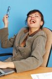 Businesswoman laughing. In office, at work Royalty Free Stock Photo