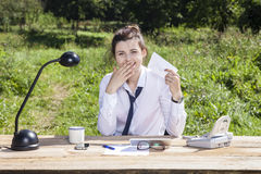 Businesswoman laughing with the contents of the envelope Stock Images