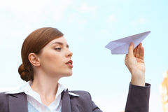 Businesswoman launches paper airplane. Royalty Free Stock Photos