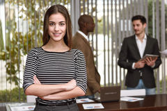 Businesswoman leader with arms crossed in working environment Stock Image