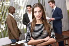 Businesswoman leader looking at camera in working environment. Stock Photos