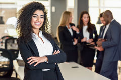 Businesswoman leader in modern office with businesspeople workin Stock Photography