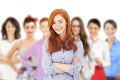 Businesswoman leading a business team and smiling Stock Image