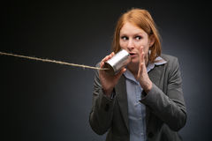 Businesswoman Leaking Corporate Secrets Royalty Free Stock Photography