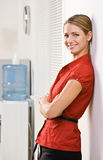 Businesswoman leaning against wall Stock Photo
