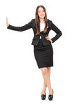 Businesswoman leaning against a wall Royalty Free Stock Images