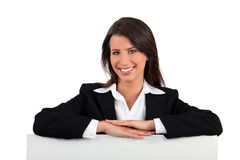 Businesswoman leaning on a board Stock Photo