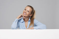 Businesswoman leaning on board Royalty Free Stock Images
