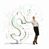 Businesswoman leaning on dollar sign Royalty Free Stock Photography