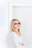 Businesswoman Leaning On Door Royalty Free Stock Photos