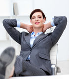 Businesswoman leaning feet on her desk Royalty Free Stock Image