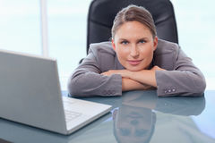 Businesswoman leaning on her desk Royalty Free Stock Photography