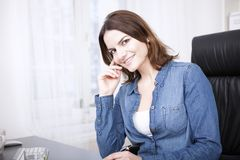 Businesswoman Leaning on her Hand at her Desk Stock Photography