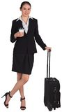 Businesswoman leaning on her suitcase holding coffee Royalty Free Stock Photography