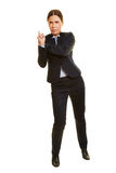 Businesswoman leaning on imaginary wall Royalty Free Stock Image