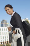 Businesswoman Leaning On Railing Royalty Free Stock Photography