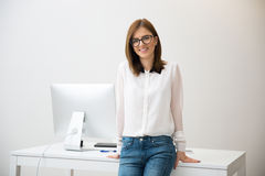 Businesswoman leaning on the table Stock Photo