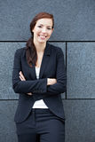 Businesswoman leaning on wall Stock Photo