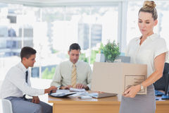 Businesswoman leaving office after being fired Stock Images