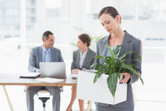 Businesswoman leaving office after being fired Royalty Free Stock Images