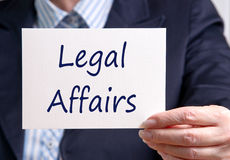 Businesswoman with Legal Affairs Sign. Businesswoman with card or sign and the words Legal Affairs Stock Photo