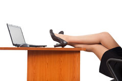 Businesswoman legs on the desk Royalty Free Stock Photography