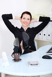 Businesswoman with legs laying on the desk Stock Photography