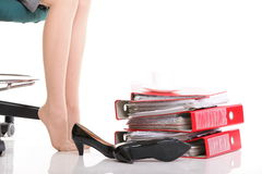 Businesswoman legs pile of ring binders reast break Royalty Free Stock Image