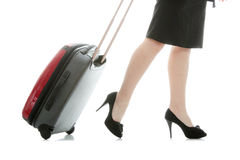 Businesswoman legs with a suitcase Stock Images