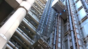 Businesswoman in a lift of Lloyds Building in London, UK stock video