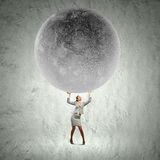 Businesswoman lifting moon Royalty Free Stock Photos