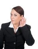 Businesswoman listening Stock Image