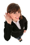 Businesswoman listening Royalty Free Stock Photo