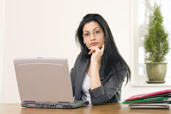 Businesswoman listening attentively Royalty Free Stock Images