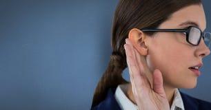 Businesswoman listening gossip against blue background. Digital composite of Businesswoman listening gossip against blue background Royalty Free Stock Photos