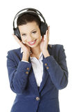 Businesswoman listening the music Royalty Free Stock Photos