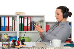 Businesswoman listening music Stock Photos