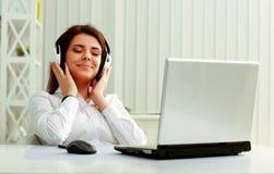 Free Businesswoman Listening Music In Headphones Stock Photos - 35695703