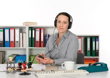 Businesswoman listening music Royalty Free Stock Photo