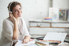 Businesswoman listening music in office Stock Images