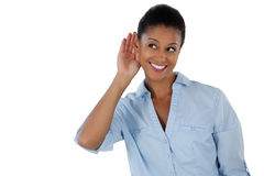 Businesswoman listening secretly with hands behind her ears Royalty Free Stock Photos