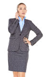 Businesswoman listening to a call on her mobile Stock Photography