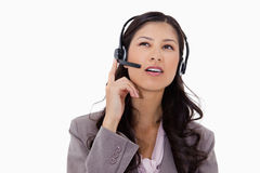 Businesswoman listening to caller with headset Stock Image