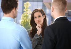 Businesswoman listening to colleagues Royalty Free Stock Photography