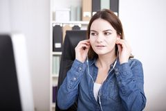 Businesswoman listening to a dictation Royalty Free Stock Photography