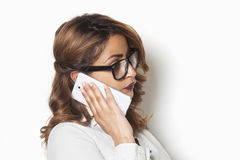 Businesswoman listening to a phone call Royalty Free Stock Images