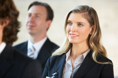 Businesswoman Listening To Speaker At Conference Royalty Free Stock Photos