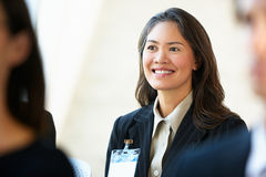 Businesswoman Listening To Speaker At Conference Stock Image